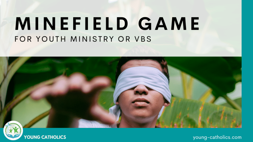 A young man with a blindfold on, reaching out with his hand, indicating that Minefield game is played blindfolded.